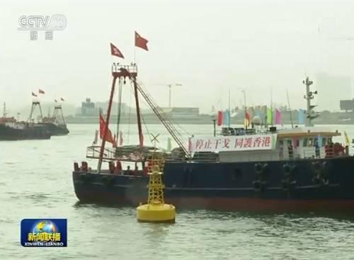 """20日,除了港岛主会场的大型集会,在九龙新界各区以及离岛都设有分会场,让自发前来的香港市民充分表达""""反对暴力""""、""""守护香港""""的心声。"""